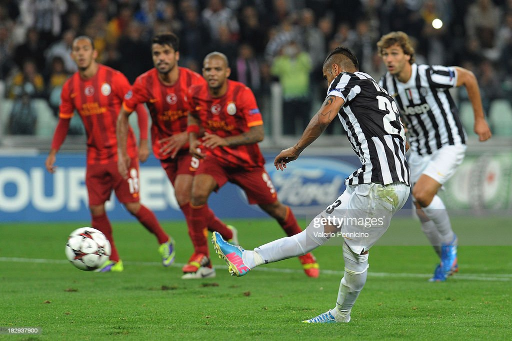 Arturo Vidal (R) of Juventus scores his team's second goal from the penalty spot during UEFA Champions League Group B match between Juventus and Galatasaray AS at Juventus Arena on October 2, 2013 in Turin, Italy.