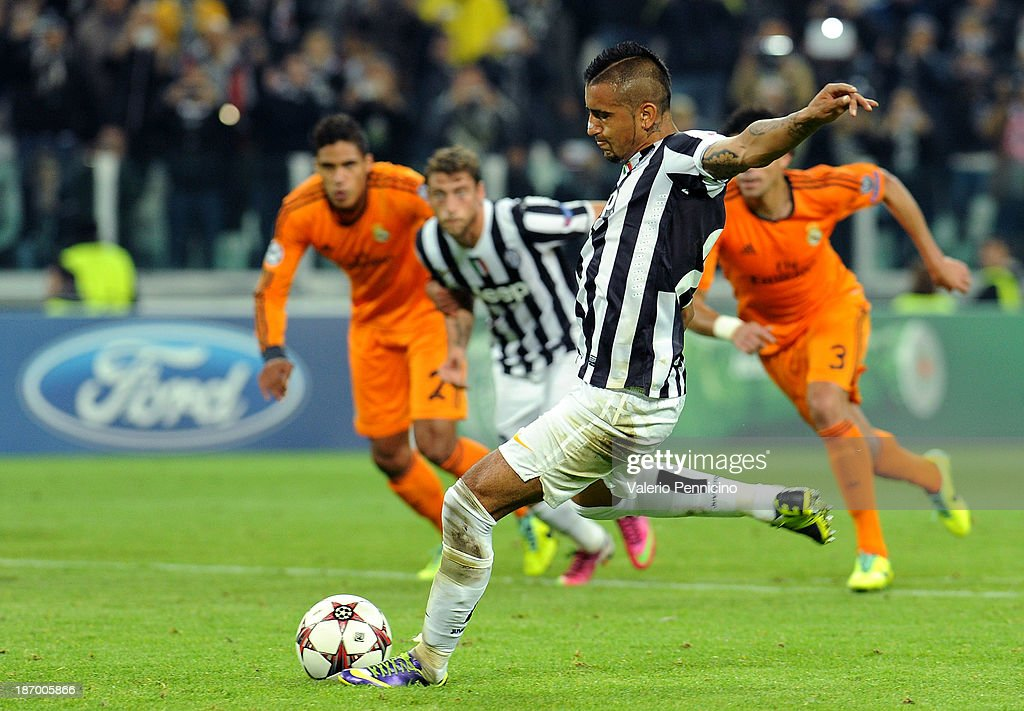 <a gi-track='captionPersonalityLinkClicked' href=/galleries/search?phrase=Arturo+Vidal&family=editorial&specificpeople=2223374 ng-click='$event.stopPropagation()'>Arturo Vidal</a> of Juventus scores the opening goal from the penalty spot during the UEFA Champions League Group B match between Juventus and Real Madrid at Juventus Arena on November 5, 2013 in Turin, Italy.