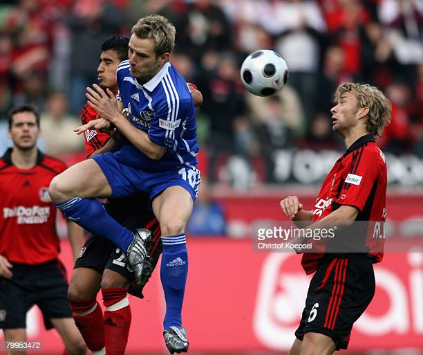 Arturo Vidal of Leverkusen and Ivan Rakitic of Schalke go up for a header during the Bundesliga match between Bayer Leverkusen and Schalke 04 at the...
