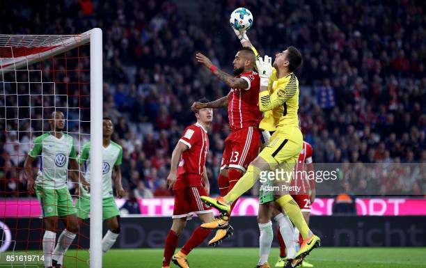 Arturo Vidal of Muenchen and Koen Cateels goalkeeper of Wolfsburg battle for the ball during the Bundesliga match between FC Bayern Muenchen and VfL...