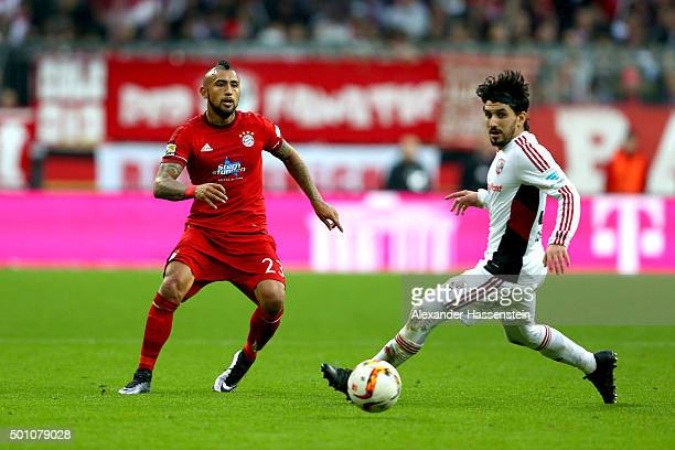 Arturo Vidal of Muenchen battles for the ball with Almong Cohen of Ingolstadt during the Bundesliga match between FC Bayern Muenchen and FC...