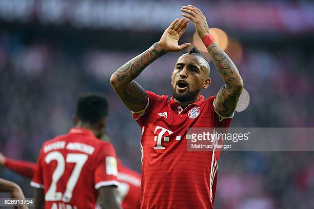 Arturo Vidal of Muenchen celebrates after Robert Lewandowski of Muenchen scores his team's second goal during the Bundesliga match between Bayern...