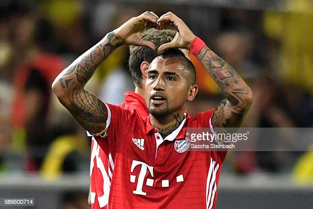Arturo Vidal of Muenchen celebrates after scoring the opening goal during the DFL Supercup 2016 match between Borussia Dortmund and FC Bayern...