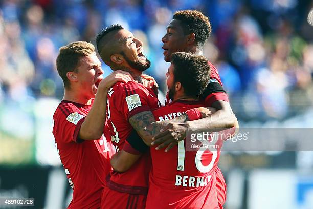 Arturo Vidal of Muenchen celebrates his team's first goal with team mates Joshua Kimmich Juan Bernat and David Alaba during the Bundesliga match...