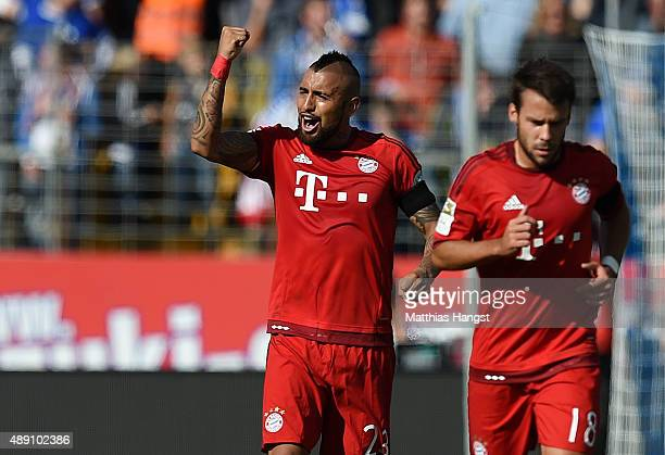 Arturo Vidal of Muenchen celebrates with his teammates after scoring his team's first goal during the Bundesliga match between SV Darmstadt 98 and FC...