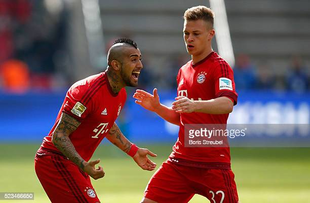 Arturo Vidal of Muenchen celebrates with team mate Joshua Kimmich after scoring his team's first goal during the Bundesliga match between Hertha BSC...