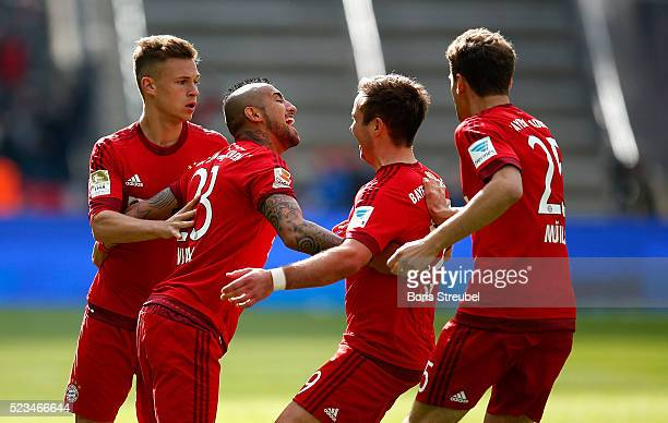 Arturo Vidal of Muenchen celebrates with team mates after scoring his team's first goal during the Bundesliga match between Hertha BSC and FC Bayern...