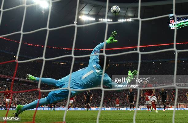 Arturo Vidal of Muenchen fails to score the 2nd goal by penalty kick during the UEFA Champions League Quarter Final first leg match between FC Bayern...