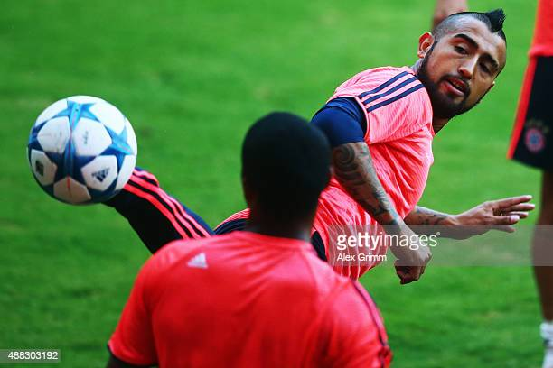 Arturo Vidal of Muenchen hits the ball during a Bayern Muenchen training session ahead of their UEFA Champions League Group F match against...