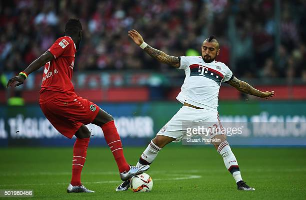 Arturo Vidal of Muenchen is challenged by Salif Sané of Hannover during the Bundesliga match between Hannover 96 and FC Bayern Muenchen at HDIArena...