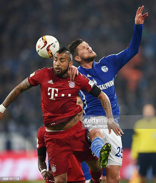 Arturo Vidal of Muenchen jumps for a header with KlaasJan Huntelaar of Schalke during the Bundesliga match between FC Schalke 04 and FC Bayern...