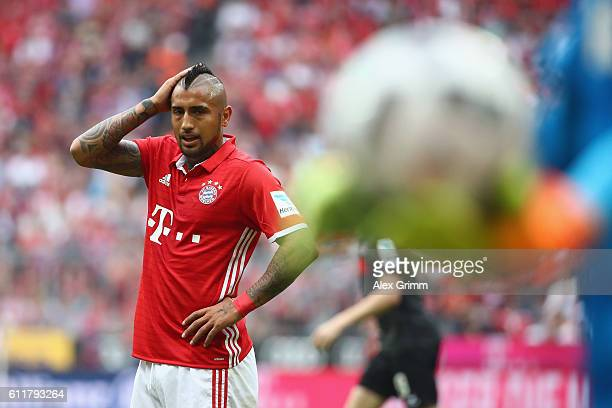 Arturo Vidal of Muenchen reacts after missing a chance to score during the Bundesliga match between Bayern Muenchen and 1 FC Koeln at Allianz Arena...