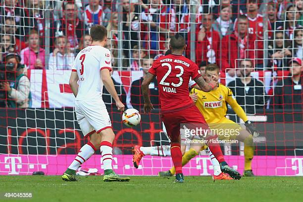 Arturo Vidal of Muenchen scores the 2nd team goal during the Bundesliga match between FC Bayern Muenchen and 1 FC Koeln at Allianz Arena on October...