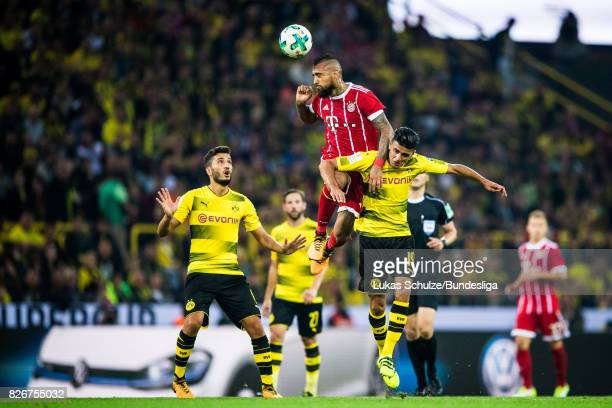 Arturo Vidal of Munich and Mahmoud Dahoud of Dortmund head the ball during the DFL Supercup 2017 match between Borussia Dortmund and Bayern Muenchen...