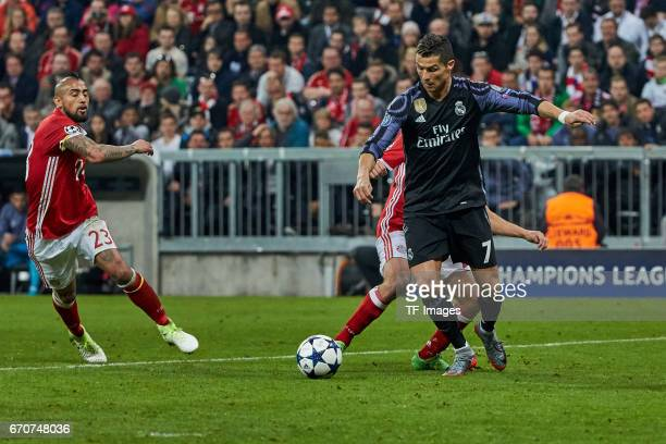 Arturo Vidal of Munich and Philipp Lahm of Munich and Cristiano Ronaldo of Real Madrid battle for the ball during the UEFA Champions League Quarter...