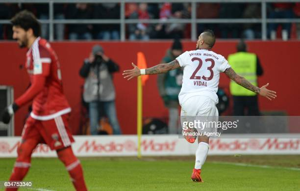 Arturo Vidal of Munich celebrates after scoring a goal during the Bundesliga soccer match between FC Ingolstadt and FC Bayern Munich at Audi...