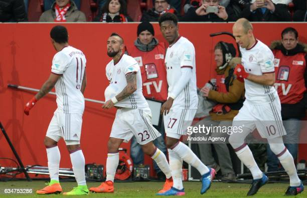 Arturo Vidal of Munich celebrates with his teammates after scoring a goal during the Bundesliga soccer match between FC Ingolstadt and FC Bayern...