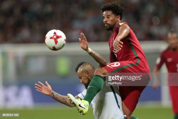 Arturo Vidal of the Chile national football team and Eliseu of the Portugal national football team vie for the ball during the 2017 FIFA...