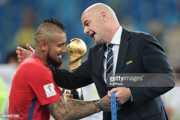 Arturo Vidal of the Chile national football team and President of FIFA Gianni Infantino during the 2017 FIFA Confederations Cup final match between...