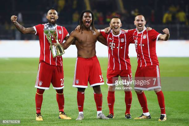 Arturo Vidal Renato Sanches Rafinha and Franck Ribery of Muenchen celebrate with the trophy after their team won the DFL Supercup 2017 match between...