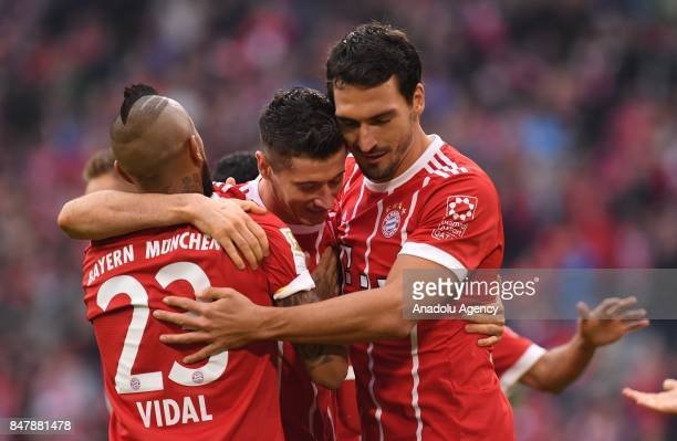Arturo Vidal Robert Lewandowski and Mats Hummels of Bayern Munich celebrate after scoring a goal during the Bundesliga soccer match between Bayern...
