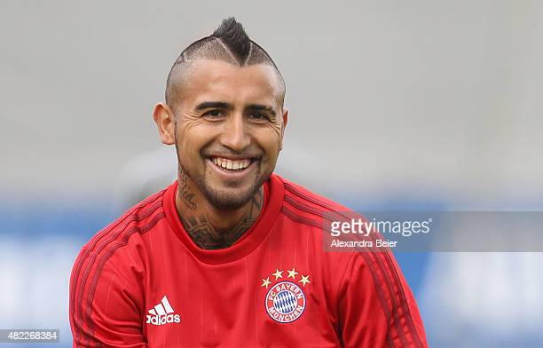 Arturo Vidal smiles during the FC Bayern Muenchen training session at Bayern's training ground Saebener Strasse on July 29 2015 in Munich Germany