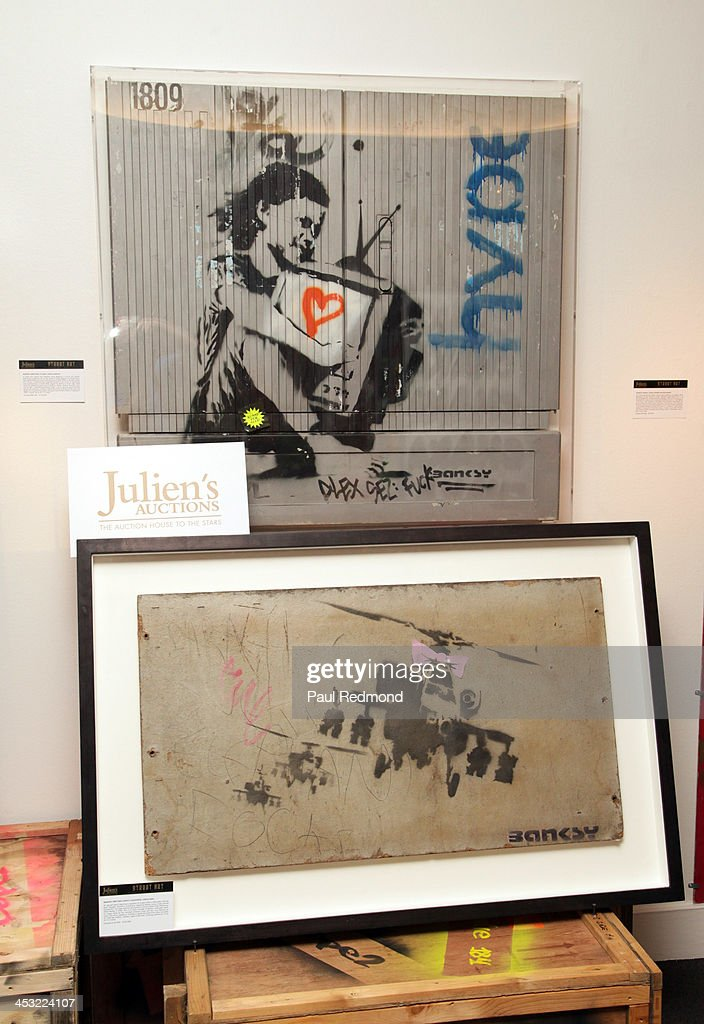 Artwork by artist Banksy at Julien's Auctions present The Trilogy Collection: Props and Costumes from Middle Earth, Street Art Auction and Icons and Idols: Rock n' Roll Memorabilia at Julien's Gallery on December 2, 2013 in Beverly Hills, California.