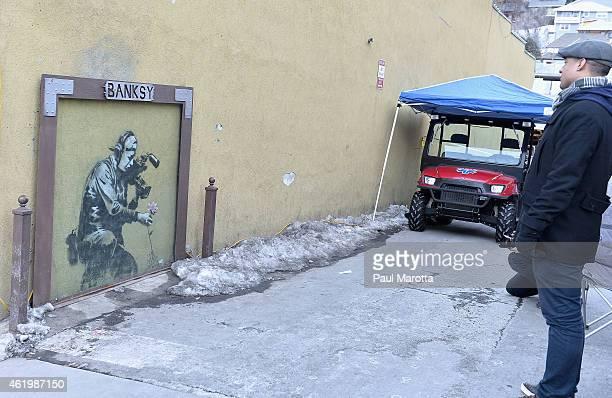 Artwork by English graffiti artist Banksy on Main Street at the 2015 Sundance Film Festival on January 22 2015 in Park City Utah