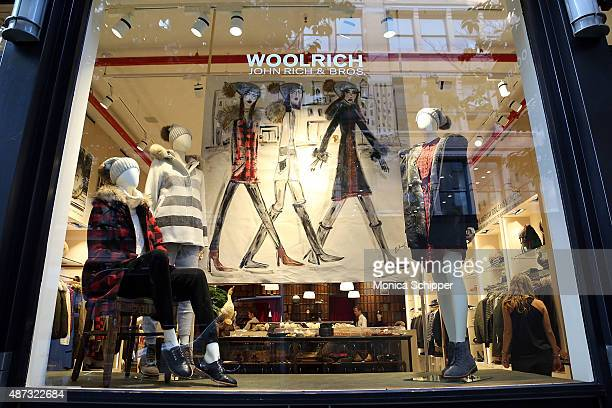 Artwork by illustrator Blair Breitenstein is seen in the Woolrich store window at Woolrich John Rich Bros celebrate Fashion Week and the opening...