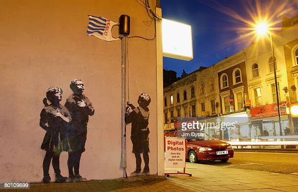 Artwork in North London attributed to guerrilla graffiti artist Banksy is pictured on Essex Road in Islington on March 4 2008 in London England The...