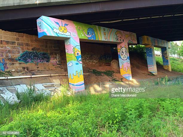 Artwork on an underpass over the Atlanta Beltline walking and jogging path Atlanta Georgia USA