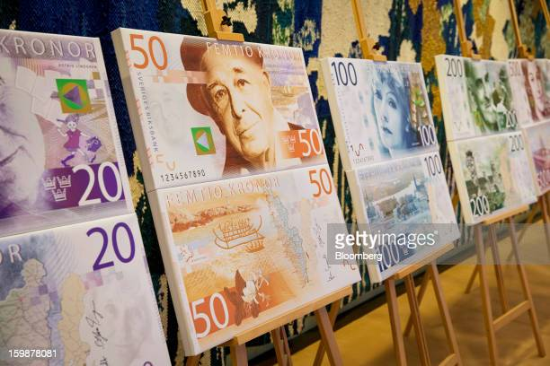 Artwork showing the designs of new folding Swedish krona or kronor currency notes due to be issued in 2014 stands on display at the Riksbank in...