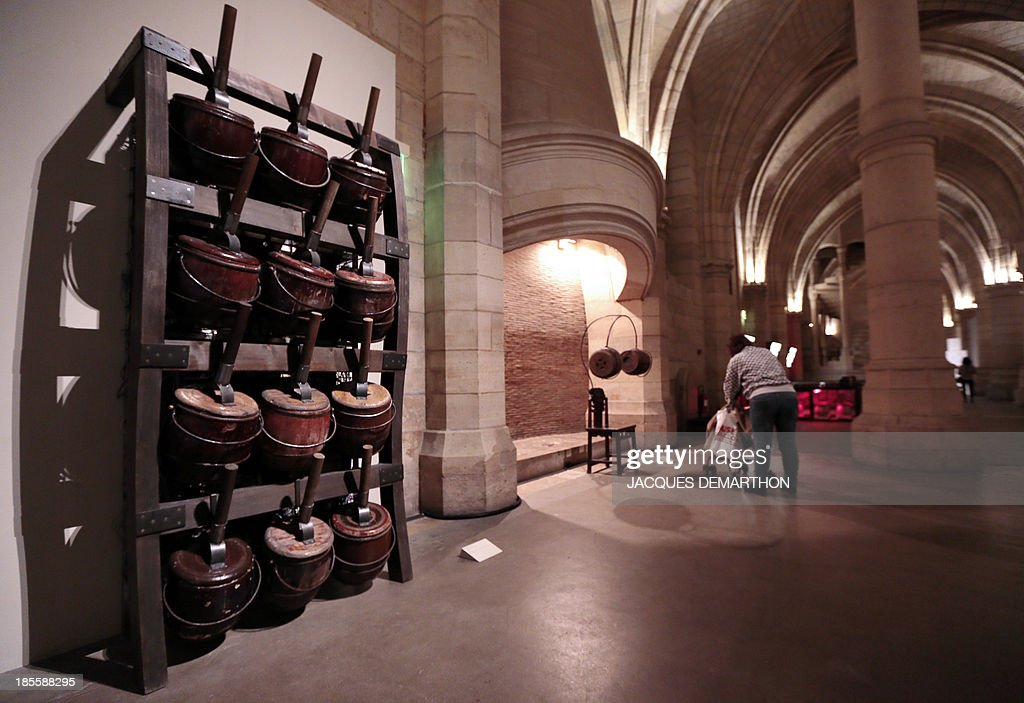 Artworks 'Bibliotheque musicale' (Musical library) and 'Chaise de concentration' (Concentration chair) by Chinese artist Chen Zen are displayed on October 22, 2013 at the Conciergerie museum in Paris, during an exhibition presenting French businessman François Pinault's contemporary art collection.