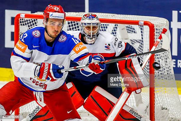 Artyom Anisimov of Russia and Julius Hudacek goalkeeper of Slovakia look at the puck during the IIHF World Championship group B match between...
