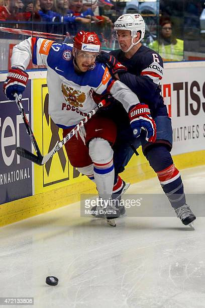 Artyom Anisimov of Russia and Mike Reilly of USA battle for the puck during the IIHF World Championship group B match between Russia and USA at CEZ...