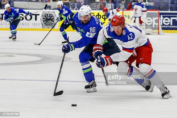 Artyom Anisimov of Russia and Sabahudin Kovacevic of Slovenia battle for the puck during the IIHF World Championship group B match between Russia and...