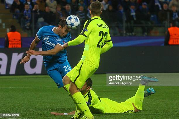 Artyom Dzuba of Zenit and Lasse Nielsen of KAA Gent in action during the UEFA Champions League Group H football match between Zenit StPetersburg and...