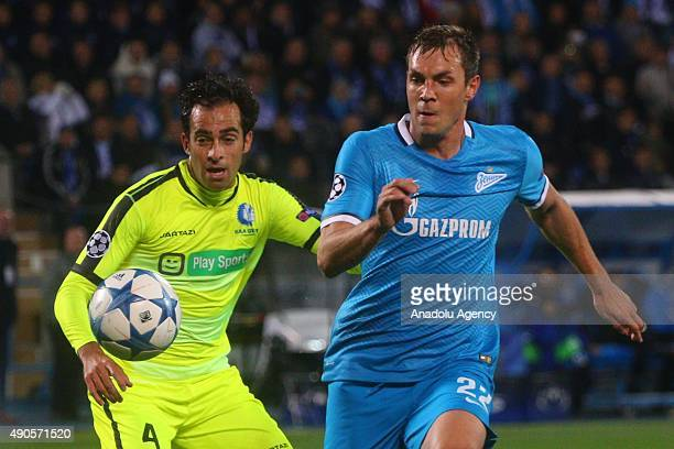 Artyom Dzuba of Zenit and Rafihna of KAA Gent in action during the UEFA Champions League Group H football match between Zenit StPetersburg and KAA...