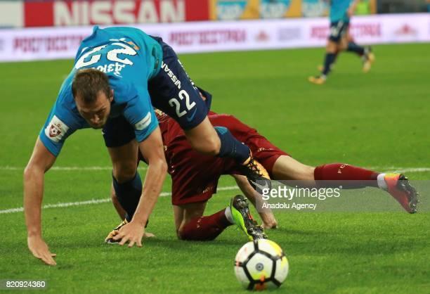 Artyom Dzuba of Zenit in action against his opponent of Rubin Kazan during the Russian Football Premier League match between Zenit St Petersburg vs...
