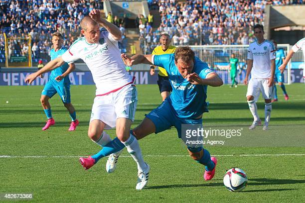 Artyom Dzuba of Zenit StPetersburg vies with Andrey Semenov of Terek during the Russian Football Premiere League football match between Zenit...