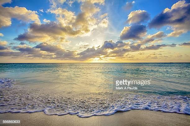 Aruba sunset over moving sea