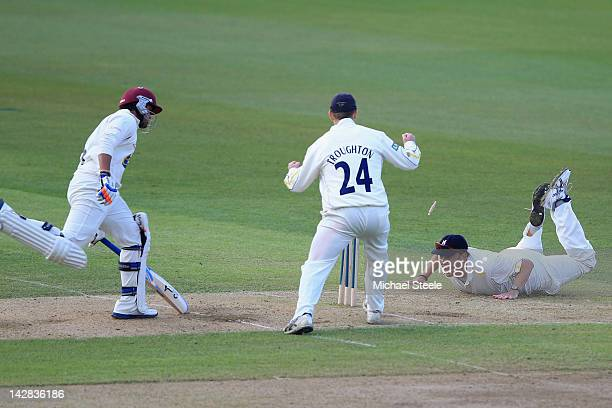 Arul Suppiah of Somerset is run out by Neil Carter of Warwickshire during day two of the LV County Championship division one match between...