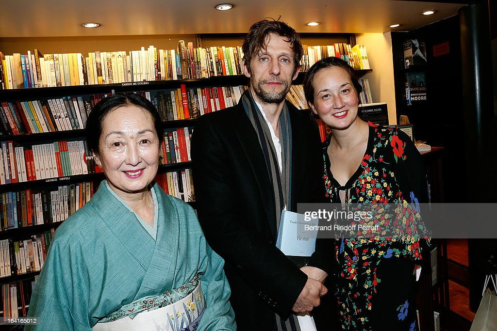 Arumi Klossowska De Rola (R) with her husband Benoit Peverelli (C) and her mother Setsuko Klossowska De Rola, the widow of late painter Balthus (L) attend the book signing of 'Dream Life' (Vie Revee) by Thadee Klossowski De Rola at Galignani Bookstore in Paris, France on March 20, 2013.