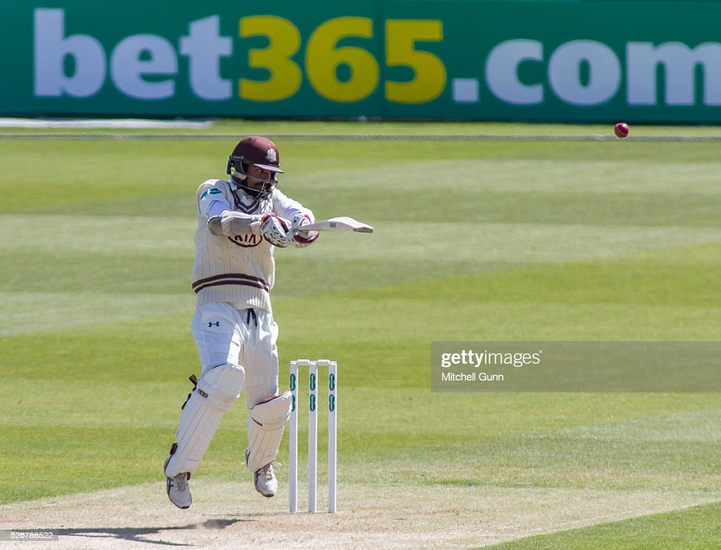 Arun Harinath hits the ball for four runs during the Specsavers County Championship Division One match between Surrey and Durham at the Kia Oval Cricket Ground, on May 01, 2016 in London, England.