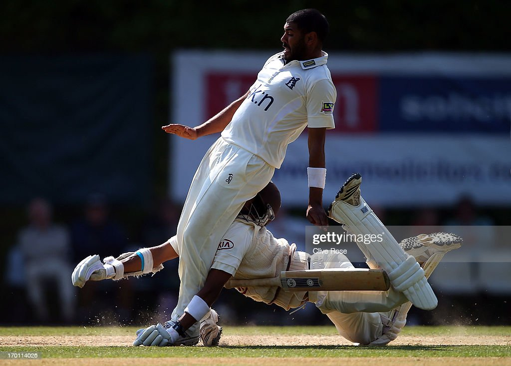 Arun Harinath of Surrey collides head first with Jeetan Patel of Warwickshire during day three of the LV County Championship Division One match between Surrey and Warwickshire at Guildford Cricket Club on June 07, 2013 in Guildford, England.