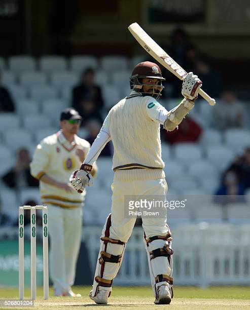 Arun Harinath of Surrey reaches his half century during day one of the Specsavers County Championship Division One match between Surrey and Durham at...