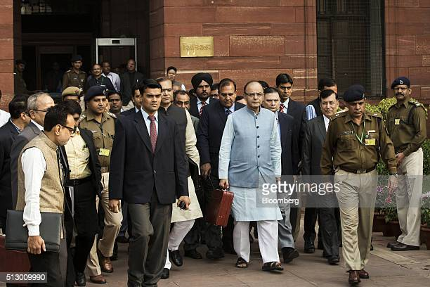 Arun Jaitley India's finance minister center and other members of the finance ministry stand leave the North Block of the Central Secretariat...