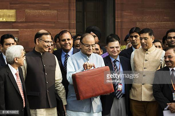 Arun Jaitley India's finance minister center Jayant Sinha junior finance minister front center left and other members of the finance ministry stand...