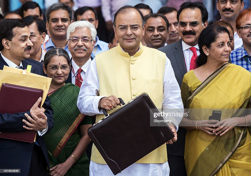 <a gi-track='captionPersonalityLinkClicked' href=/galleries/search?phrase=Arun+Jaitley&family=editorial&specificpeople=2660950 ng-click='$event.stopPropagation()'>Arun Jaitley</a>, India's finance minister, center, Pompa Babbar, financial commissioner of railways, front row second left, Arvind Mayaram, finance secretary, second row second right, Nirmala Sitharaman, industry and commerce minister, front row right, and other members of the finance ministry stand for a photograph outside the North Block of the Central Secretariat building before leaving to table the budget in parliament in New Delhi, India, on Thursday, July 10, 2014. The budget deficit will narrow to 4.1 percent of gross domestic product in the year through March 2015, as projected by the previous administration, Jaitley said while presenting Modis first budget in New Delhi. Photographer: Graham Crouch/Bloomberg via Getty Images