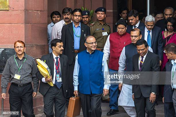 Arun Jaitley India's finance minister front row center and other members of the finance ministry leave the North Block of the Central Secretariat...